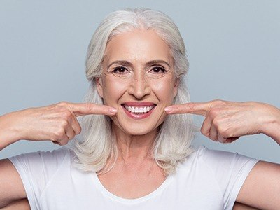 woman pointing to dental crowns