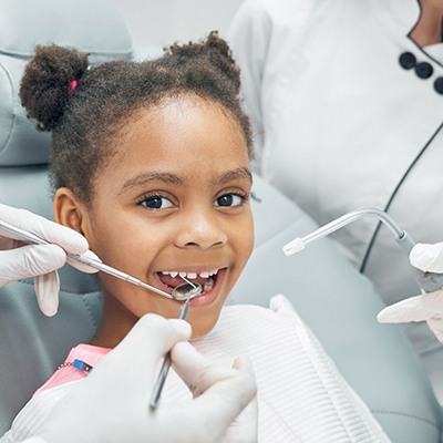 child getting a dental cleaning
