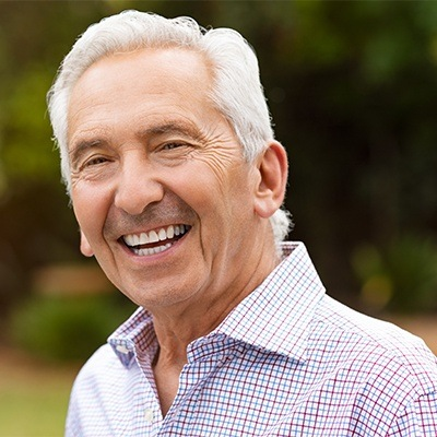 man smiling with dentures