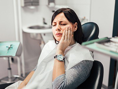 woman with watch on in pain
