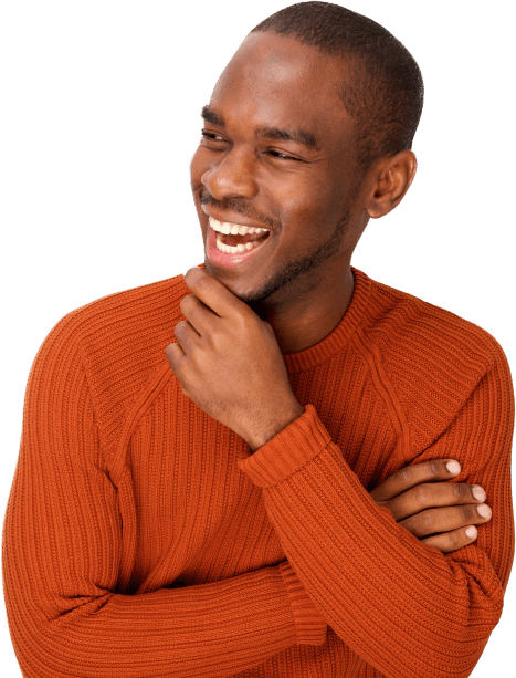 man in orange sweater smiling