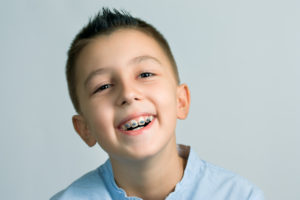 little boy smiling with braces