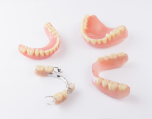 Variety of dentures on a white background