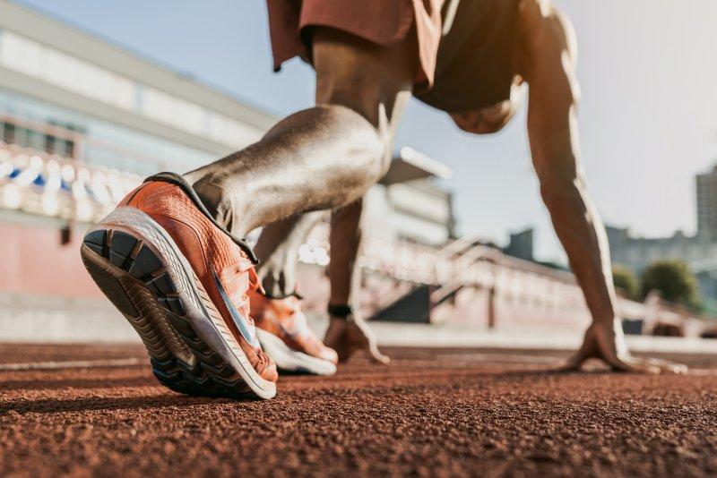 Closeup of man on track preparing to run
